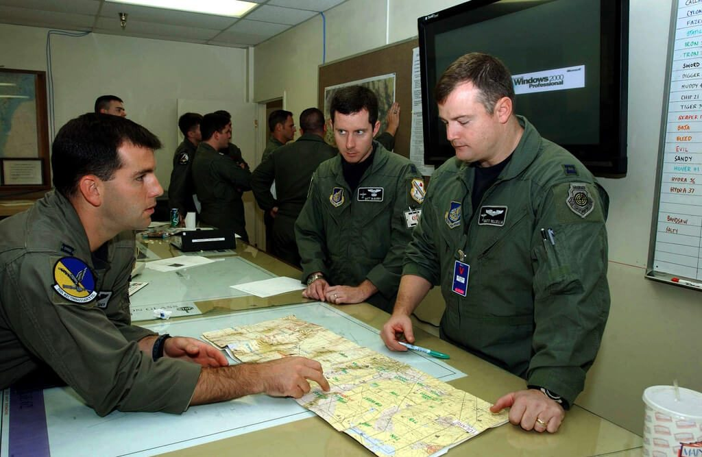 Pilots discuss flight plans prior to a mission in support of Exercise RED FLAG 2002