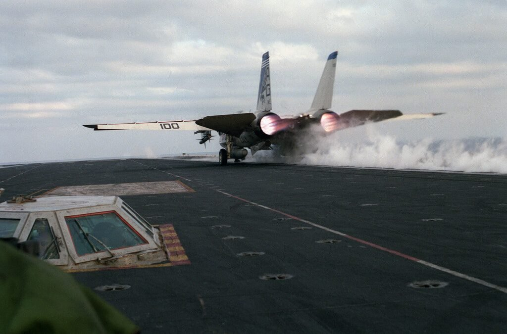 f-14 Tomcat launching from aircraft carrier - dale snodgrass